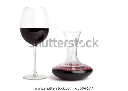 Wine glass and a carafe filled with red wine, isolted on white