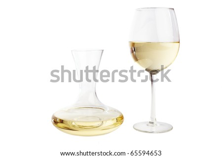 Wine glass and a carafe filled with white wine, isolted on white