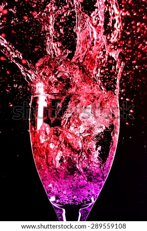 wine glass and splash colored water red