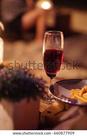Wine glass at night of dinner. #660877909