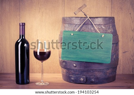 Wine glass, bottle, old wood barrel and sign board