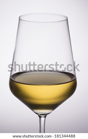 Wine Glass lit from behind on concentric white gray background