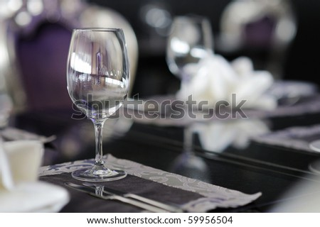 Wine glass on a table decorated for an event celebration - stock photo