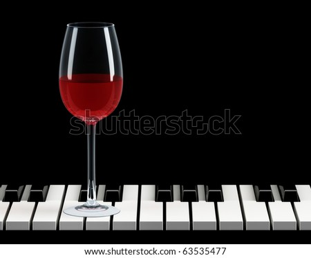 wine glass on piano key
