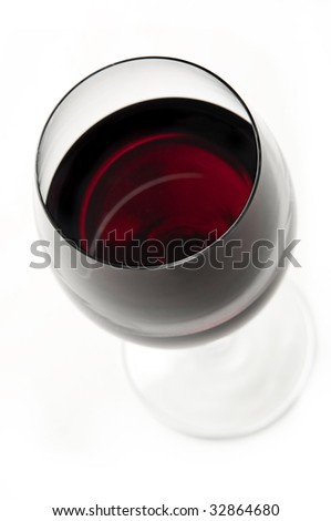 wine glass on white background, beautiful red color, merlot wine, focus is on the rim of the glass