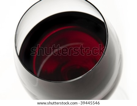 stock photo : wine glass on white background, beautiful red color, merlot