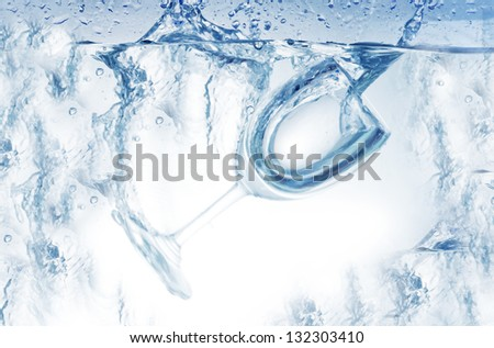 wine glass sinking in pure water