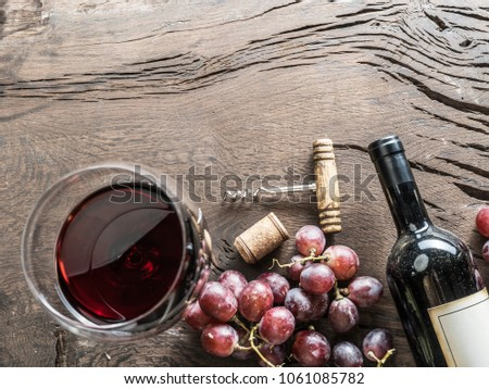 Wine glass, wine bottle and grapes on wooden background. Wine tasting. #1061085782