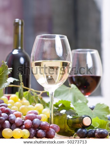 Wine glass with  bottle of wine
