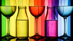wine glasses and bottles in a row with colorful light painting behind, Set of wine glasses with red, white and rose wine, banner, alcohol drinks