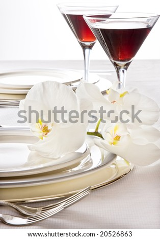 Wine glasses and orchids on a dinner or wedding table