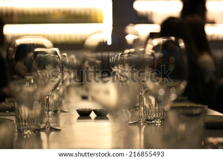 Wine glasses defocused in bar and restaurant and blurred background