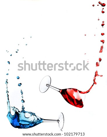 wine glasses falling with blue and red liquid
