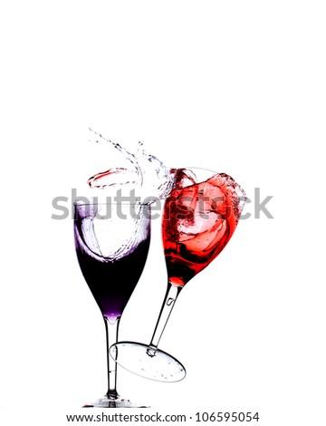 wine glasses falling with blue liquid