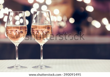 Wine glasses in a restaurant setting.