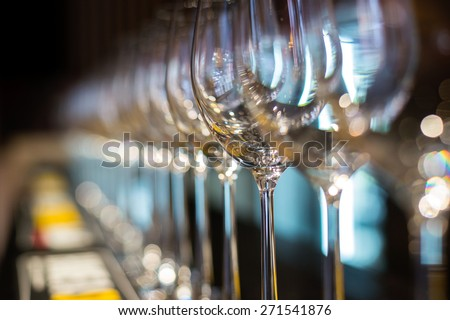 Wine glasses in row on bar