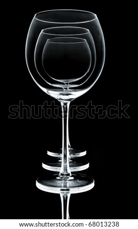 wine glasses in row on black background