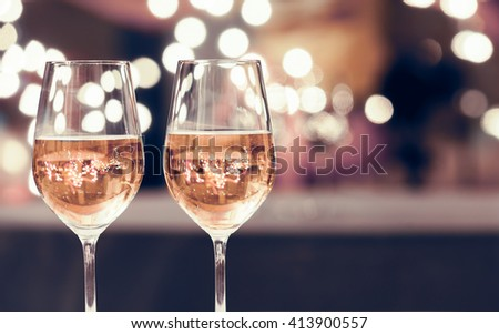 Wine glasses on a bar.