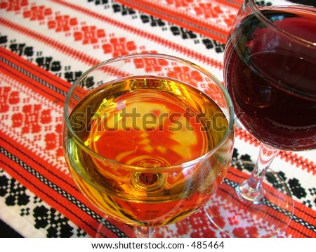 wine glasses on a patterned table-cloth
