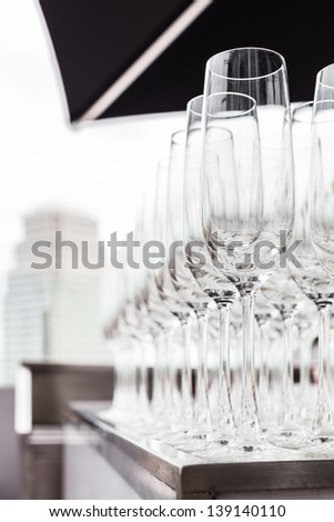 wine glasses prepared for wedding party with the view of another hotel background