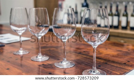 Wine Glasses Sitting On Wooden Table At A Bar Inside An Italian