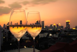 Wine glasses with city view
