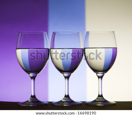 wine glasses with colored background refracted