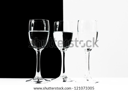 Wine glasses with white and black background reflection