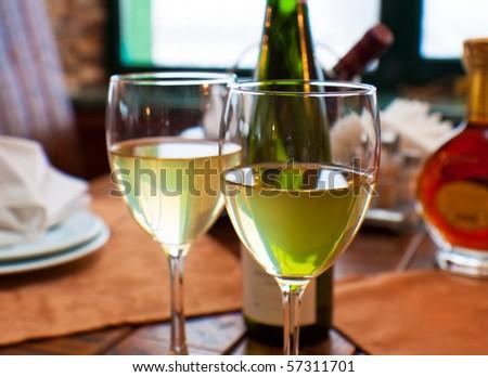 Wine goblets on restaurant table. Shallow DOF