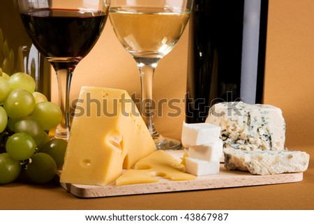 Wine, grapes and different  kinds of cheese still-life