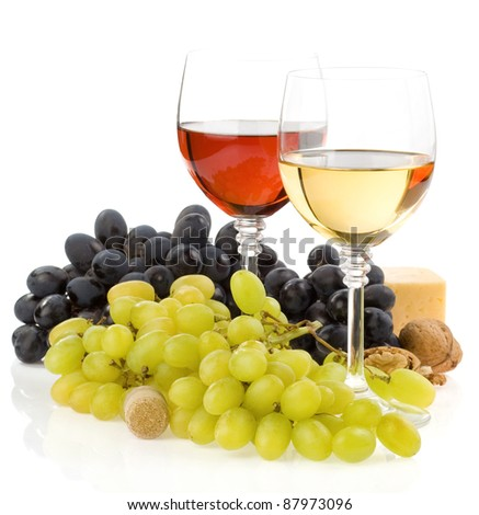 wine in glass and fruit isolated on white background