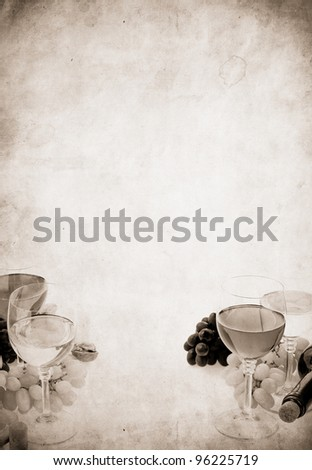 wine in glass and grape fruit on old paper parchment background