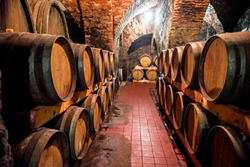 Wine in wooden barrels is stored. Wine cellar