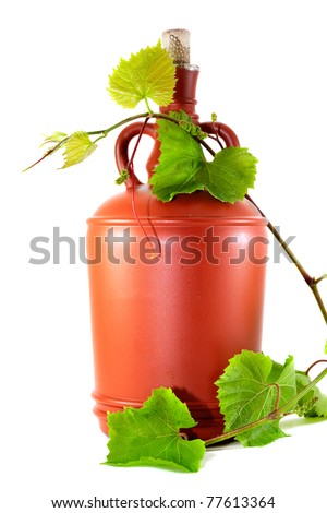 Wine jug and grape vine on white background.