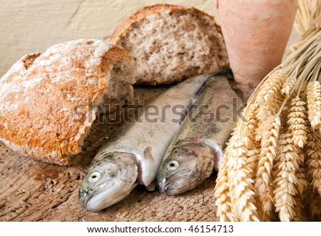 Wine jug, bread and fish as symbols of christian religion