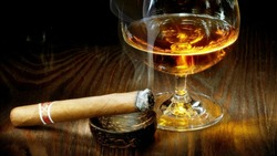 Wine of glass with burning cigarette