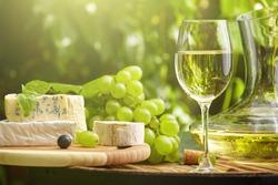 wine on wooden barrel on green garden terrace