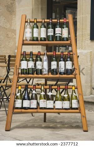 wine rack with empty wine bottles - saint-emilion, france