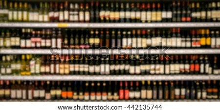 Wine shelves in supermarket, out of focus, unrecognizable. #442135744