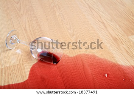 wine spill on wood - spilled glass of red wine - stock photo