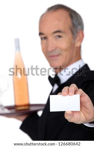 Wine steward showing a business card