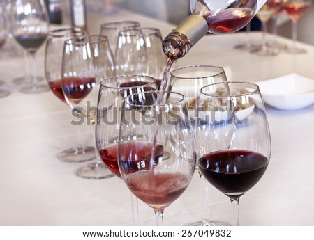 Wine tasting: rose wine being poured into a glass