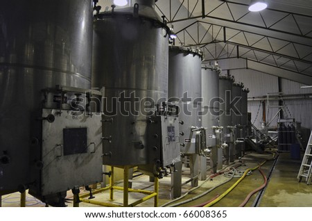 Wine vats during fermentation at a winery in the Adelaide Hills, South Australia. - stock photo