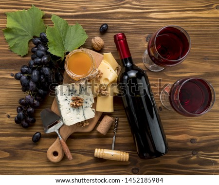 Wine with food on wooden background #1452185984