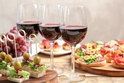 Wine with tasty bruschetta served on table