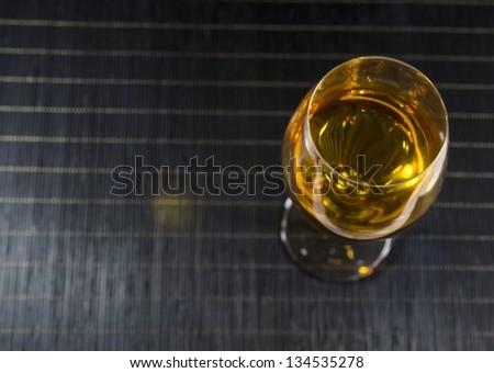Wineglass with white wine - stock photo