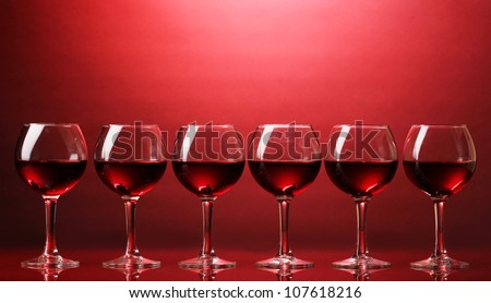Wineglasses on red background