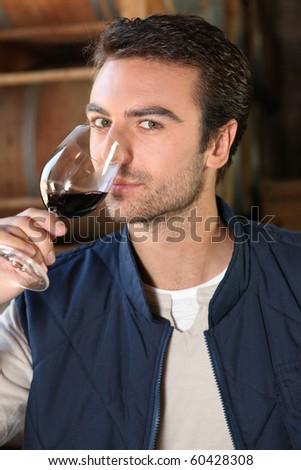 Winegrower with glass of red wine Stockfoto ©