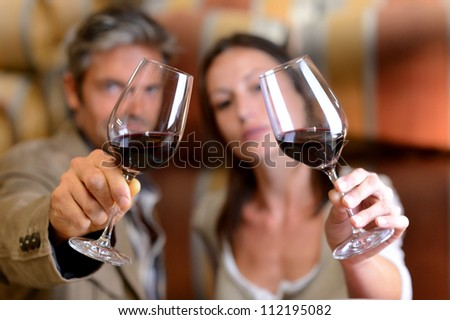 Winemakers holding glasses of red wine
