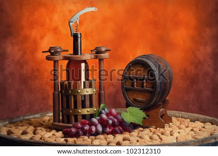winepress with a bottle and keg in still life